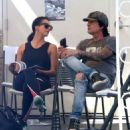 Rocker Tommy Lee and his fiance Sofia Toufa stop by a car wash in Calabasas, California on May 12, 2016. Tommy sat by himself and sent some text messages before returning to Sofia's side