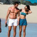 Lucy Watson in Bikini Top and Shorts on the beach in Barbados - 454 x 505