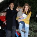 Orlando Bloom, wife Miranda Kerr, and son Flynn visit a friend