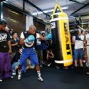 Floyd Mayweather Jr. (L) works out with Nate Jones at the Mayweather Boxing Club on September 2, 2014 in Las Vegas, Nevada - 454 x 303