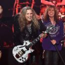 """Joel Hoekstra and singer David Coverdale of Whitesnake perform at The Joint inside the Hard Rock Hotel & Casino as the band tours in support of """"The Purple Album"""" on June 4, 2015 in Las Vegas, Nevada."""