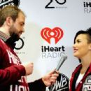Demi Lovato and host Nick Jonas attend 101.3 KDWB's Jingle Ball 2014 presented by Sky Zone Indoor Trampoline Park and Allstate at Xcel Energy Center on December 8, 2014 in St Paul, Minnesota