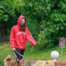 Aubrey Plaza – Dons red hoodie while out walking her dogs in Los Feliz