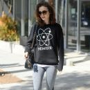 Lily Collins stops by a gym for a morning workout in Beverly Hills, California on March 27