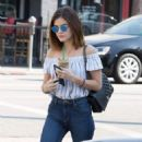 Actress and singer Lucy Hale stops by Starbucks in Los Angeles, California to pick up an iced coffee on August 24, 2016 - 454 x 566