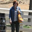 Couple Alyson Hannigan and Alexis Denisof spend some time together at a park in Brentwood, California on July 17, 2015 - 432 x 600