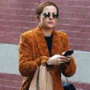 Zoey Deutch in a bathrobe style jacket shopping in Manhattan