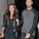 Calvin Harris' romance with stunning model Aarika Wolf heats up as they share a passionate kiss on private jet