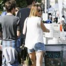 Miley Cyrus spent her Sunday, February 12, shopping with her boyfriend, Liam Hemsworth and pal, Cheyne in Los Angeles