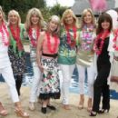 Turning back the clock: Nina Carter, third right, stands with, left to right, Susie Juul, Ingrid Tarrant, Carole Ashby, Sara Walkden, Jilly Johnson, Vicki Michelle and Tilly Mezzina