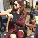 Bottoms up! Doctor Who's Jenna Coleman shares a drink with Games of Thrones star boyfriend Richard Madden at Glastonbury
