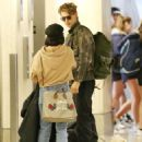 Vanessa Hudgens and Austin Butler at LAX Airport in LA - 454 x 582