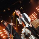 Musicians Nikki Sixx and James Michael of Sixx A.M. perform for iHeartRadio Live at The iHeartRadio Theater Los Angeles on October 7, 2014 in Burbank, California. - 395 x 594