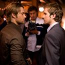 """Jason (Mike Vogel, left) attends a going-away party for his brother Rob (Michael Stahl-David, right) in """"Cloverfield."""" Photo Credit: Sam Emerson. © 2008 by Paramount Pictures. All Rights Reserved."""