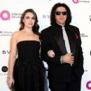 Sophie Simmons and musician Gene Simmons attend the 24th Annual Elton John AIDS Foundation's Oscar Viewing Party at The City of West Hollywood Park on February 28, 2016 in West Hollywood, California. - 454 x 356