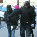 Singer Pink goes for a walk with her husband Carey Hart and their daughter Willow on a chilly morning in New York City, New York on December 12, 2013