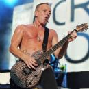 Phil Collen - During Def Leppard's performance at the Cruzan Amphitheatre in West Palm Beach, Florida on June 15, 2011 - 454 x 567