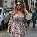 Kelly Brook – Wearing a flower print dress in London