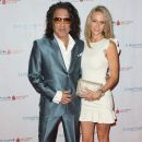 Musician Paul Stanley of KISS and Erin Sutton attend the Spirit of Excellence Awards 2014 at the Hyatt Regency Century Plaza on September 23, 2014 in Century City, California. - 390 x 594
