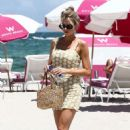 Charlotte McKinney in Mini Dress on the beach in Malibu - 454 x 681