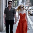 Ellie Bamber in Red Dress With Richard Madden – Out in Milan