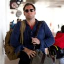 Michael Weatherly arrives at LAX (Los Angeles International Airport) carrying two handfuls of luggage