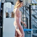 Hailey Bieber – In a pearl pink velvet slit cut dress in Santa Monica