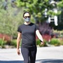 Jennifer Garner takes a walk with a friend in her neighborhood of Brentwood