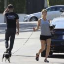 Elisabetta Canalis takes her two dogs for a walk in Los Angeles