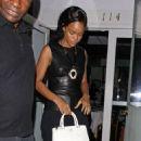 Rihanna shields her eyes from camera flashes as she leaves Il Ristorante di Giorgio Baldi - 454 x 573