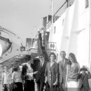 July 29th, 1963 - The Rt Hon Sir David Ormsby-Gore KCMG went aboard the Queen Mary on her arrival today at Southhampton with his children Julian (22, dark glasses), Jane (20) and Victoria (16) to meet his wife Lady Ormsby-Gore, daughter Alice (11, with co - 454 x 383