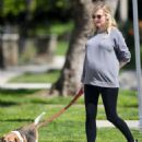 Kirsten Dunst with her dog out in LA