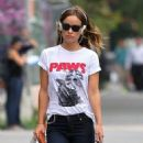 Olivia Wilde pokes fun at 'Jaws' with a cat shirt as she takes a walk in New York City on August 19, 2013