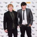 Rupert Grint attended the F1 Party today, July 4, in London. Rupert attended the event with his brother James