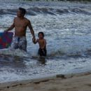 Actor Hiro Kanagawa who plays Cyrus on Caprica at beach with his son! - 454 x 340
