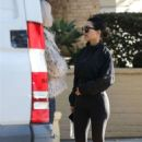 Kourtney Kardashian in Black Outfit at a friend's house in West Hollywood