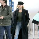 Margot Robbie in Long Coat at JFK Airport in NY