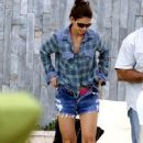 Katie Holmes relaxes by the pool of her Miami Beach hotel while on vacation