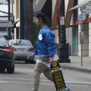 Justin Bieber takes his skateboard to an office in Beverly Hills on January 10, 2016