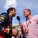 Daniel Ricciardo of Australia and Infiniti Red Bull Racing speaks with David Coulthard on the grid before the United States Formula One Grand Prix at Circuit of The Americas on November 2, 2014 in Austin, United States