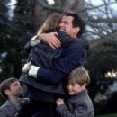Pierce Brosnan as Desmond Doyle, getting to see his daughter Evelyn (Sophie Vavasseur) and sons Dermot (Niall Beagan) and Maurice (Hugh McDonagh) in MGM's Evelyn - 2002