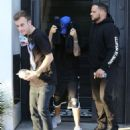 Justin Bieber hides his face as he leaves the Nine Zero One Salon in West Hollywood, California on January 27, 2015