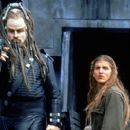 Terl (John Travolta) and Jonnie Goodboy Tyler (Barry Pepper) in Warner Brothers' Battlefield Earth - 2000