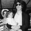 Bianca Jagger and Mick Jagger holding their toddler daughter Jade in 1974