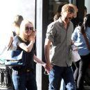 A smitten looking Dakota Fanning and her boyfriend Jamie Strachan go hand in hand for a stroll around New York City - 384 x 594