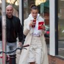 Bella Hadid in Long Coat and Ripped Pants out in London