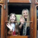 Railway Children star Sally Thomsett and her daughter Charlie, 13, arrive at Oakworth station - 454 x 302