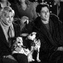 Alice Evans (left) stars as Cruella's reluctant probation officer Chloe and Ioan Gruffudd (right) stars as dog shelter owner Kevin, both of whom share a love for their canine friends in Walt Disney's 102 Dalmatians - 2000