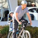 Josh Duhamel is spotted enjoying a bicycle ride with his growing son Axl on January 8, 2016 in Brentwood - 454 x 595