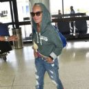 Kristin Chenoweth departing on a flight at LAX airport in Los Angeles, California on September 4, 2015 - 452 x 600